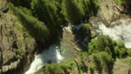 MS AERIAL Shot of Gunsight Mountain waterfall in Glacier National Park / Montana, United States