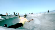 WS SLO MO Shot of Guy skating in skate park bowl / Venice, California, United States