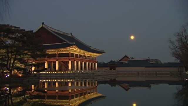 MS T/L Shot of Gyeonghoeru(Korea's National Treasure No. 224) hall in Gyeongbokgung Royal Palace at day to night / Seoul, Jongno gu, South Korea