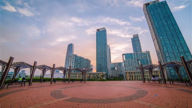 WS ZO POV Shot of Haedoji Park behind skyscrapers in the Songdo Business District at night / Songdo, Incheon, South Korea