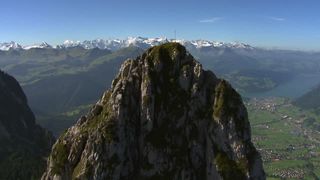 MS AERIAL Shot of Haggenspitz and Kleiner Mythen, Grosser Mythen in background / Mythen, Schwyz, Switzerland
