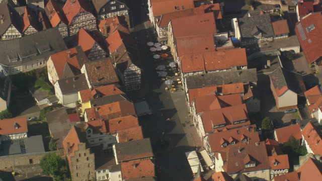 MS AERIAL Shot of half timbered houses with streets at Fritzlar / Germany