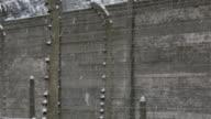 CU PAN Shot of 'Halt' sign at Auschwitz with snow rain / Auschwitz-Birkenau, Krakow, Poland