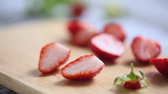 CU R/F Shot of hand cutting Strawberry / Seoul, South Korea