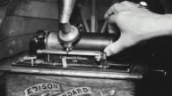 CU Shot of hand enters to adjust phonograph (Insert)