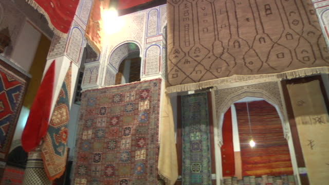 MS PAN Shot of hand made rugs inside of building in city / Fes, Centro-North, Morocco