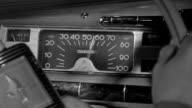 CU Shot of hand on steering wheel and speedometer
