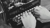 CU Shot of hands typing on typewriter
