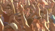 CU Shot of Hands up of crowd clapping in day  / Victoria Park, London, United Kingdom