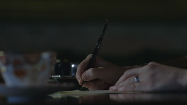 CU R/F Shot of hands writing letter with fountain pen / United Kingdom