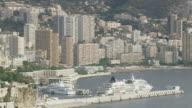 MS AERIAL ZO Shot of harbor along with tall buildings near coast / Monaco, France