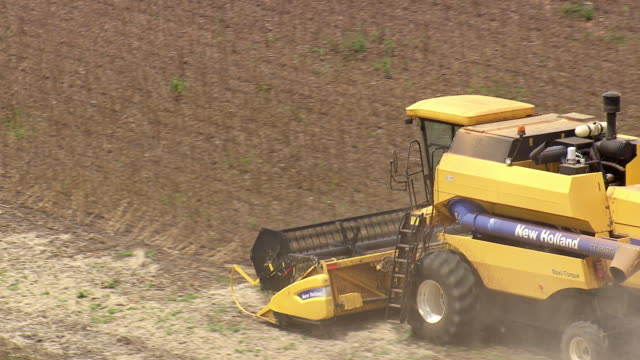 CU AERIAL Shot of harvesting in field with machine / Brazil