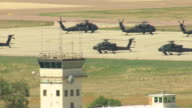 MS DS AERIAL Shot of helicopters on tarmac at united states army installationfFort carson / Colorado Springs, Colorado, United States