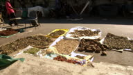 MS Shot of herbs drying in the sun at Warwick Junction herb market / Durban, South Africa