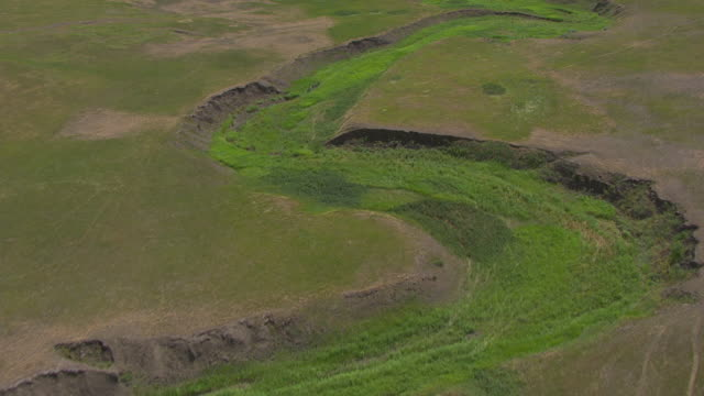 MS AERIAL TU Shot of high over dry river bed running through plains in Dewey County / La Plant, South Dakota, United States
