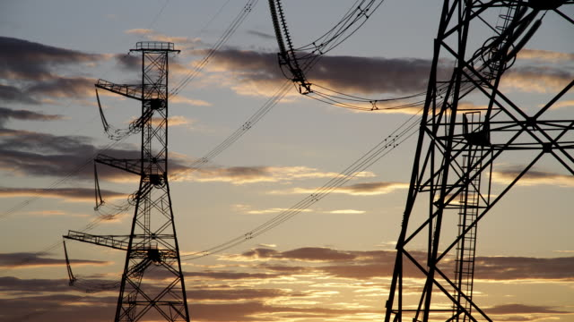 MS T/L Shot of High voltage power pylons with clouds at sunset / Moscow, Russia