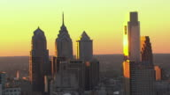 MS AERIAL Shot of highrise buildings downtown during sunset / Philadelphia, Pennsylvania, United States
