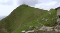 MS AERIAL Shot of hiking trail with mountain guest house / Schafler, Appenzell Innerrhoden, Switzerland