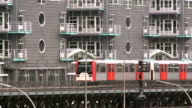 MS Shot of Hochbahn (city railway) passing in front of GrunerJahr Building / Hamburg, Germany