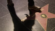 CU PAN Shot of Hollywood walk of fame - Matt Damon with people walking / Los Angeles, California, United States