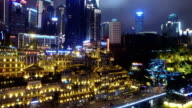 WS AERIAL shot of Hongyadong entertainment complex and cityscape at night/ Chongqing,China