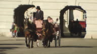 MS PAN Shot of horse cart moving at Michaelerplatz / Vienna, Austria