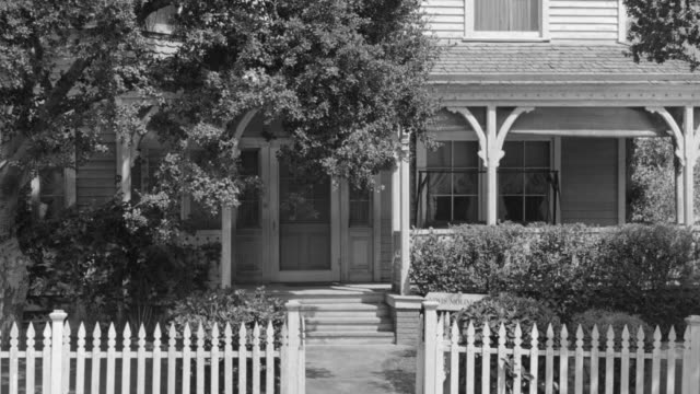 MS ZI Shot of house with white picket fence and trees in front yard