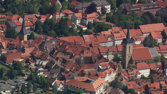 MS AERIAL Shot of houses and buildings rooftops at Duderstadt / Germany