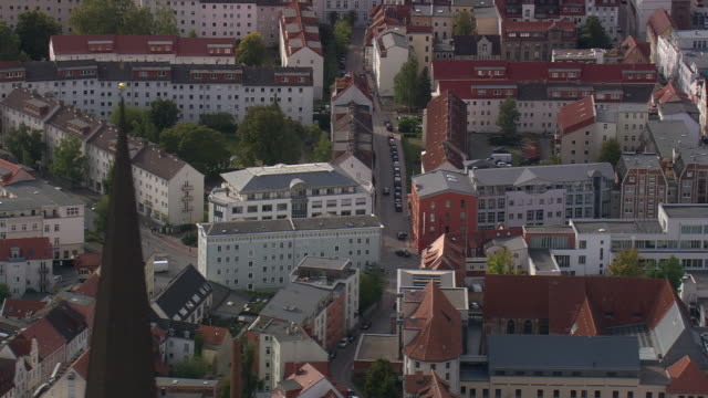 MS AERIAL Shot of houses, buildings with cars on street at Rostock / Germany