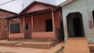 MS POV Shot of houses in village along road side / Serra Pelada, Para, Brazil