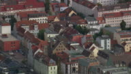 MS AERIAL Shot of houses rooftops at Rostock / Germany