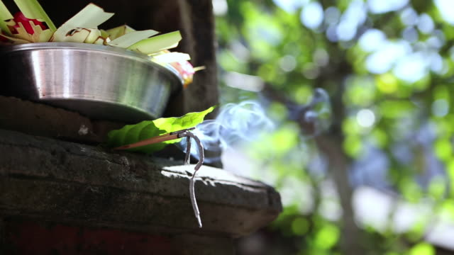CU Shot of incense burning in temple / Ubud, Bali, Indonesia