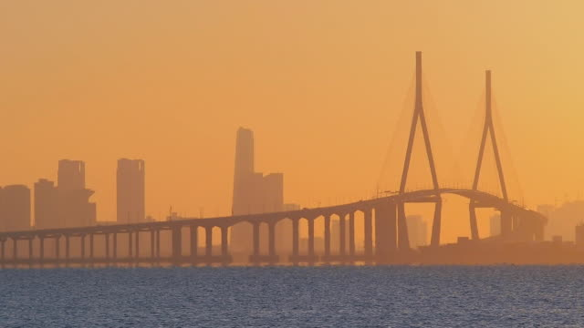 MS Shot of Incheon Bridge at Songdo Business District at sunset / Incheon, South Korea