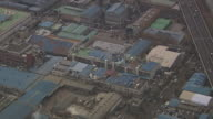 MS AERIAL Shot of Industrial complex making smoke at Incheon / Incheon, South Korea