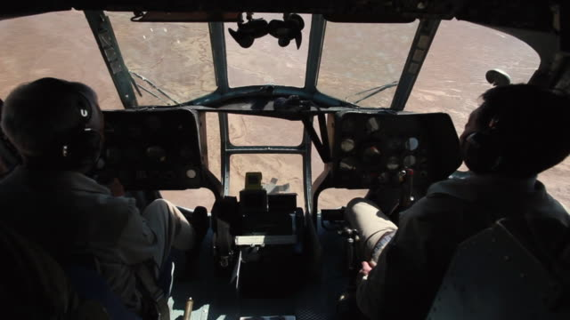 MS Shot of inside cockpit of Mongolian Mi-8 Helicopter mid air / SuhBaatar, Mongolia, Mongolia