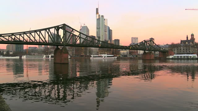 WS Shot of Iron Bridge (Eiserner Steg) at Main river with cityscape / Frankfurt, Main, Hesse, Germany