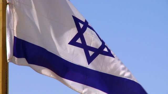 CU Shot of Israeli Flag blowing in wind / Shivta, Negev, Israel