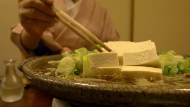 CU Shot of Japanese style food and kimono woman / Taito ku, Tokyo, Japan