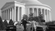MS Shot of Jefferson Memorial and People get into taxi cab in front side