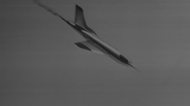MS AERIAL POV Shot of jet flying down side