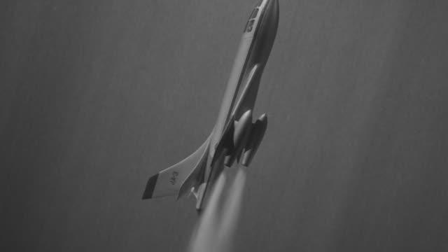 MS AERIAL POV Shot of jet flying upper side