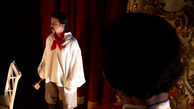 MS Shot of John Wilkes Booth acting on stage glaring at President Abraham Lincoln in audience at Fords Theatre / United States