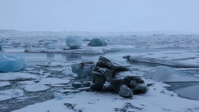 MS PAN Shot of Jokulsarlon Lagoon and glaciers at morning with snow covers glaciers / Iceland