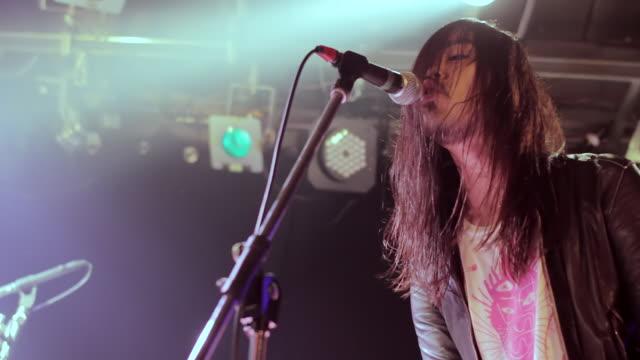 MS TD Shot of Keyboard player singing on stage / Shimokitazawa, Tokyo, Japan