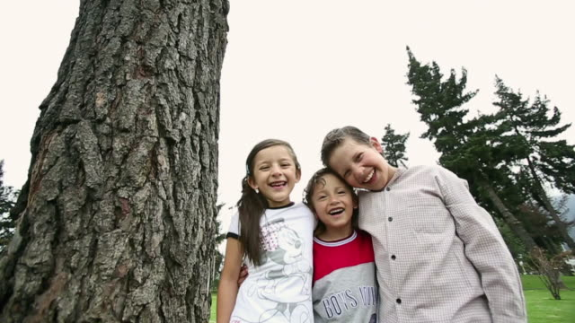 MS SLO MO Shot of kids smiling / Quito, Ecuador