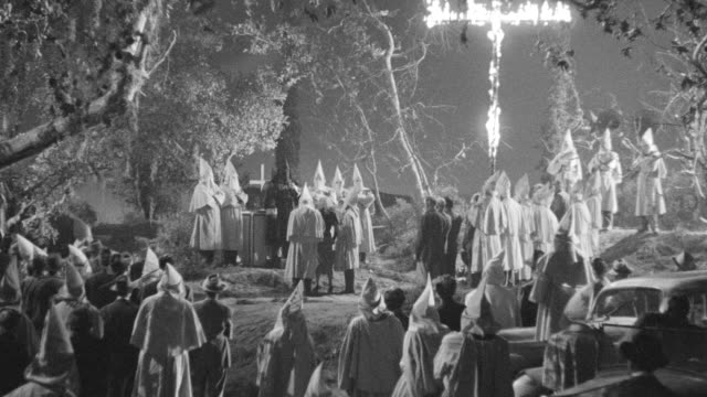WS Shot of  Klan rally, burning a cross