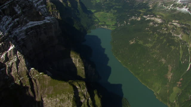 MS AERIAL Shot of Klontal Lake and Glarnisch northern flanks / Klontal, Glarus, Switzerland