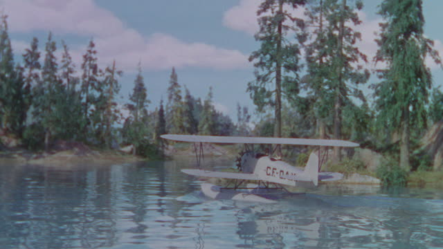 MS TS Shot of lake with trees in back side with boat plane going away (miniature)