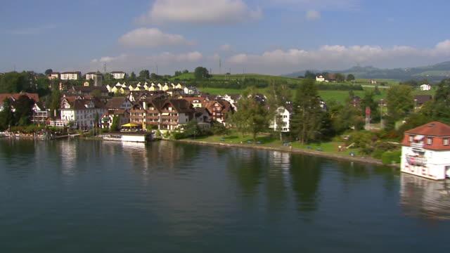 MS AERIAL Shot of lakeside at Lake Zug / Immensee, Schwyz, Switzerland
