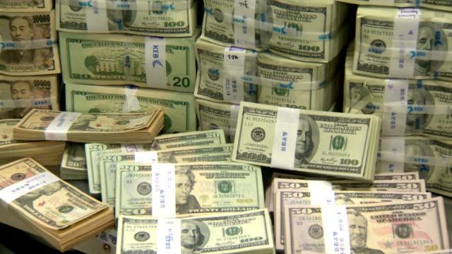 Shot of large group of stacking foreign exchange bundle in Korea Exchange Bank